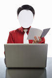 Faceless businessman and laptop Stock Image