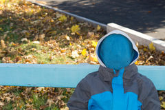 Faceless child Stock Images