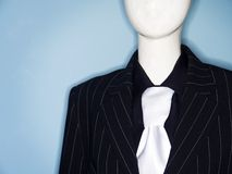 Faceless dummy model dressed in business suit and tie. Photo of faceless dummy model dressed in business suit and tie Royalty Free Stock Photo
