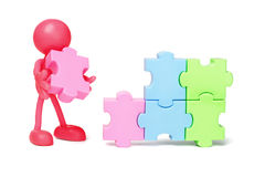 Faceless figurine and jigsaw puzzles Stock Photo