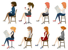 Faceless girls sitting down. On a white background Royalty Free Stock Images