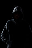 Faceless guy in hoodie in the darkness Royalty Free Stock Image