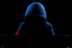 Faceless Hacker using computer Royalty Free Stock Photo