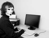Faceless Helpdesk. A woman, with an expressionless mask on, to portray the concept of today�s faceless, anonymous, helpdesk type communication Royalty Free Stock Images