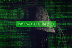 Faceless hooded anonymous computer hacker Stock Image