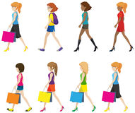 Faceless ladies walking. In one direction on a white background Stock Photo