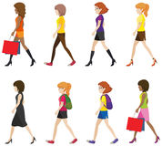 Faceless ladies walking. In one direction on a white background Royalty Free Stock Photography