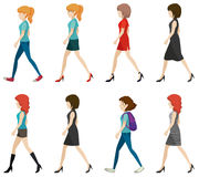 Faceless ladies walking in one direction Stock Photos