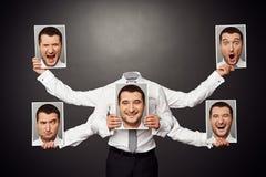 Faceless man choosing mood. Concept photo over dark background stock photo