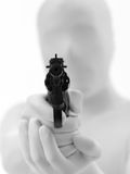 Faceless man with gun. Faceless man dressed in white aims gun at you stock images