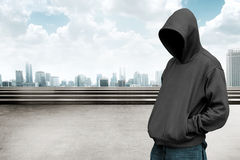 Faceless man in hood Stock Photography