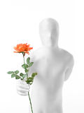 Faceless man with rose. Faceless man dressed white with a rose in hand royalty free stock images