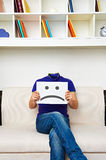 Faceless man sitting on sofa. And have a bad mood royalty free stock photos