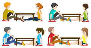 Faceless people sitting across each other Royalty Free Stock Photo