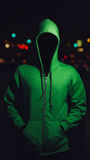Faceless person in green hoodie