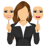 Faceless woman holding happy and angry mask Stock Image