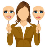 Faceless woman holding happy and angry mask Royalty Free Stock Photo
