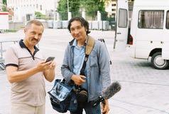 Facendo un film circa i giochi olimpici a Mosca nel 1980 - condizione e sorridere dell'ingegnere sano Fotografia Stock