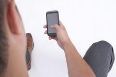 Facendo uso di un telefono cellulare Fotografia Stock