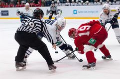 Faceoff. MOSCOW - JANUARY 10: R. Kosual (19) and M. Glumac (16) on faceoff on hockey game Vityaz vs Medvezchak on Russian KHL premier hockey league Championship Stock Images