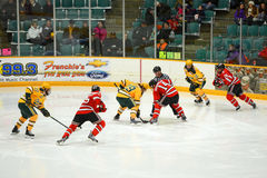 Faceoff in NCAA Hockey Game Stock Images
