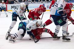 Faceoff rumble. MOSCOW - JANUARY 10: R. Kosual (19) and M. Glumac (16) on faceoff rumble on hockey game Vityaz vs Medvezchak on Russian KHL premier hockey league Royalty Free Stock Image