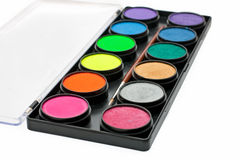 Facepaint palette and brush over white background stock image
