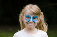 Facepainting. Girl with long blond hair with facepainting stock photography