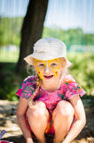 Facepainting. Little girl with bright colorful facepainting stock images
