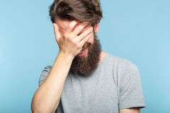 Facepalm ashamed embarrassed man covering face royalty free stock photo