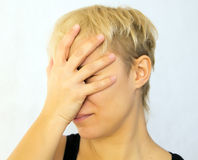 Facepalm. Young woman with hand on her face, facepalm Royalty Free Stock Photos