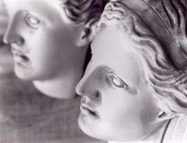 The faces of 2 female statues stock photo