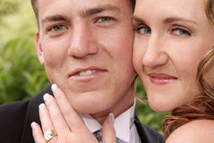 Faces. A portrait of a bride and groom standing close Royalty Free Stock Photography