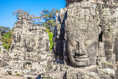 Faces of ancient Bayon Temple At Angkor Wat Stock Photos