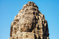 Faces of ancient Bayon Temple At Angkor Wat Stock Photo