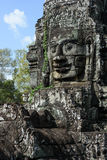 Faces of ancient Bayon Temple Stock Images