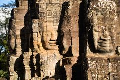 Faces of ancient Bayon temple. Popular tourist attraction in Angkor Thom, Siem Reap, Cambodia Royalty Free Stock Photography
