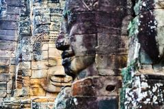 Faces of ancient Bayon temple. Popular tourist attraction in Angkor Thom, Siem Reap, Cambodia Stock Photos