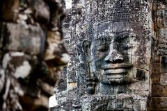 Faces of ancient Bayon temple. Popular tourist attraction in Angkor Thom, Siem Reap, Cambodia Royalty Free Stock Photo