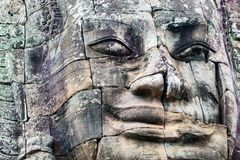 Faces of ancient Bayon temple. Popular tourist attraction in Angkor Thom, Siem Reap, Cambodia Stock Photo