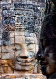 Faces of ancient Bayon temple. Popular tourist attraction in Angkor Thom, Siem Reap, Cambodia Stock Image