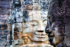 Faces of ancient Bayon temple. Popular tourist attraction in Angkor Thom, Siem Reap, Cambodia Stock Images