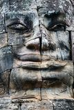 Faces of ancient Bayon temple. Popular tourist attraction in Angkor Thom, Siem Reap, Cambodia Royalty Free Stock Images