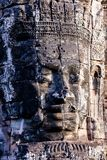 Faces of ancient Bayon temple. Popular tourist attraction in Angkor Thom, Siem Reap, Cambodia Royalty Free Stock Image
