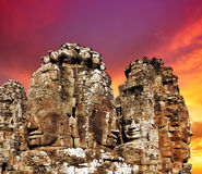 Faces of ancient Bayon Temple on sunset Stock Images