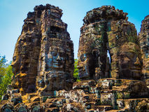 Faces in Bayon Temple, Angkor Thom. Huge carved faces in Cambodia Royalty Free Stock Images