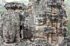 Faces of Bayon temple in Angkor Thom at Siemreap, Cambodia. Faces of Bayon temple in Angkor Thom at Siemreap on Cambodia Royalty Free Stock Images