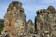Faces of Bayon temple in Angkor Thom at Siemreap, Cambodia. Faces of Bayon temple in Angkor Thom at Siemreap on Cambodia Royalty Free Stock Image