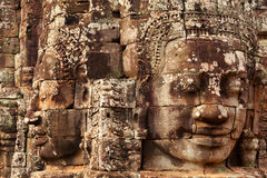 Faces in Bayon Temple, Angkor Wat, Cambodia. Two faces in Bayon Temple at daylight, Angkor Wat, Cambodia Stock Image