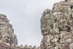 The faces at the Bayon Temple, Siem Riep, Cambodia. Face Royalty Free Stock Images